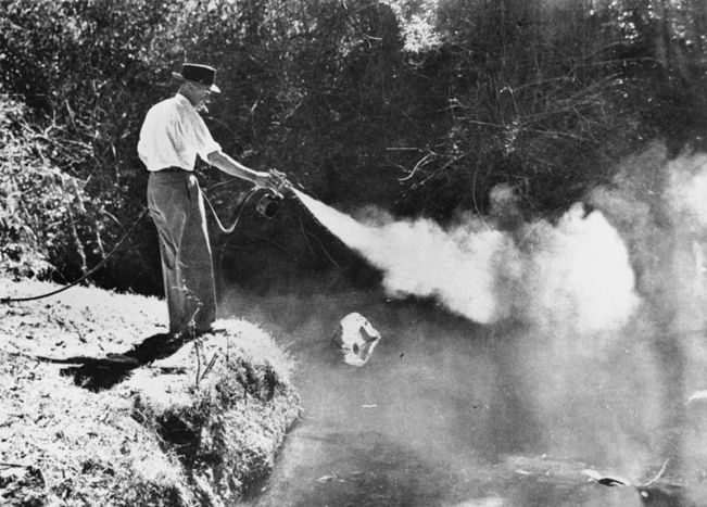 800px-statelibqld_2_164451_using_a_spray_gun_to_spray_for_mosquitos_brisbane_1946